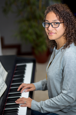 Woman playing the piano inside
