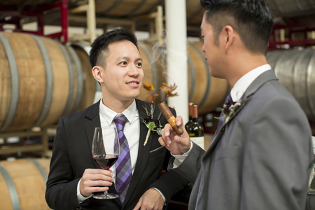 Gay couple at a winery on their wedding day
