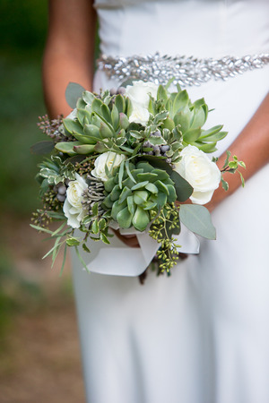 Bride holding a succulent bouquet on her wedding