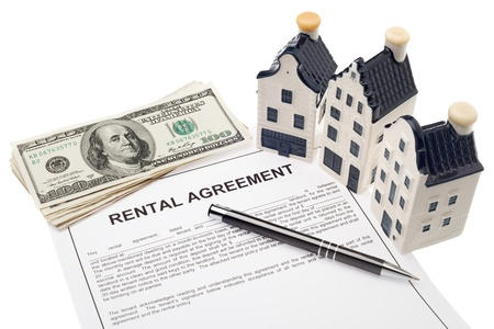 House with rental agreement and cash photo
