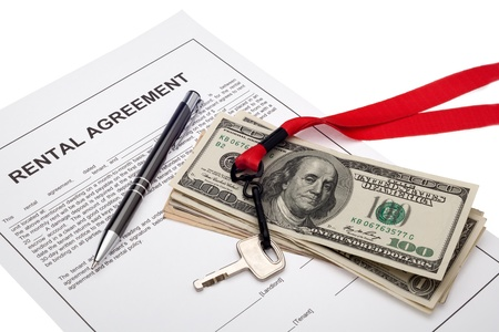 property management: House key and cash with rental agreement