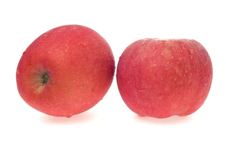 Apples with water droplets on white background