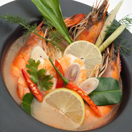 yum: Tom yum goong spicy Thai seafood soup Stock Photo