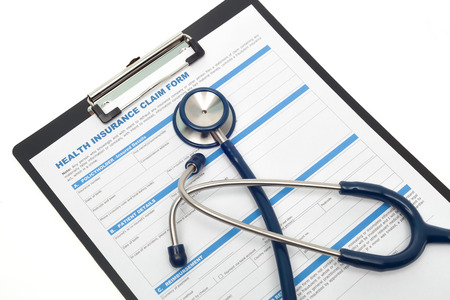 reimbursement: Medical and health insurance claim form with stethoscope on clipboard isolated Stock Photo