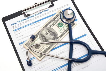 doctor with dollars: Medical and health insurance claim form with stethoscope on clipboard isolated Stock Photo
