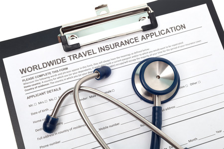 International travel medical insurance application with stethoscope photo
