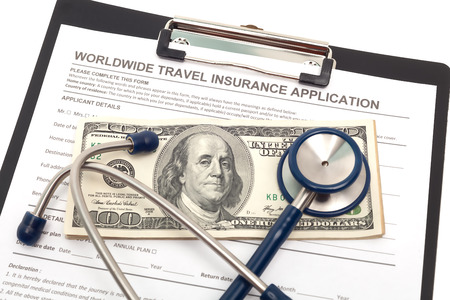 Global travel medical insurance application with stethoscope photo
