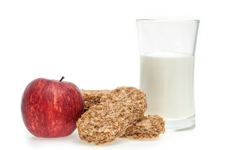 Healthy eating cereal bar and apple with milk photo