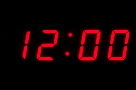 digital clock: Digital time at twelve with red digits