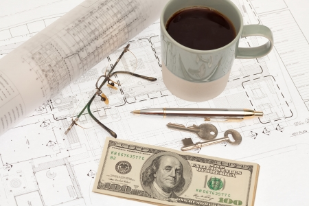 Architectural project with coffee and money