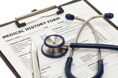Medical history form on clipboard with stethoscope