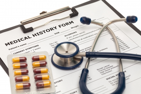 medical history: Medical history form with pills and stethoscope