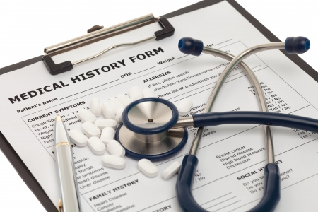 medical history: Patient medical history document with pills and stethoscope Stock Photo