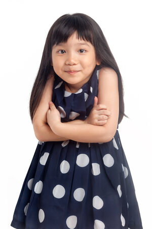 Little girl oops with arms folded isolated on white background photo