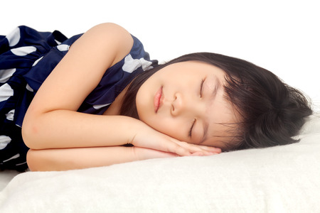 Girl sleeping on white background