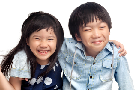 Happy kids laughing together on white background photo