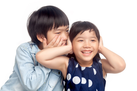 Boy and girl  playing together on white background photo
