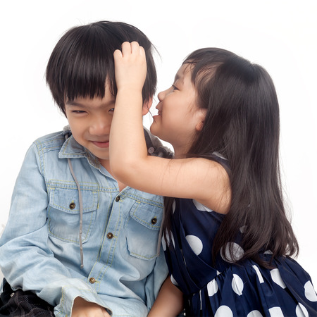 Kids whispering on white background photo