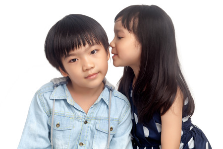Kids sharing secret on white background photo