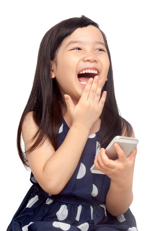 Happy kid playing on smartphone on white background