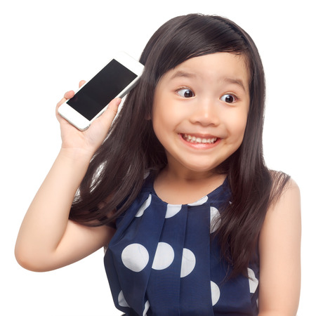 Kid surprised with smartphone on white background photo
