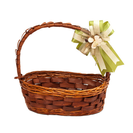 Wicker basket with gift bow isolated on white
