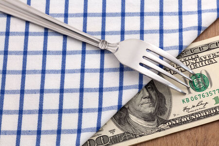 Fork with money for food business concept photo