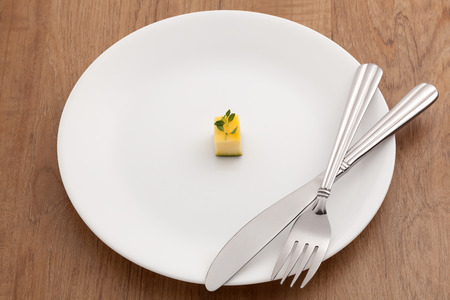 Diet concept with small food on plate Stock Photo