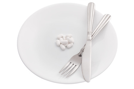 Supplement pills on plate on white background photo
