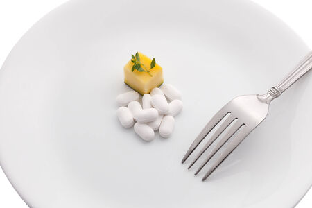 Dietary supplements on white plate photo