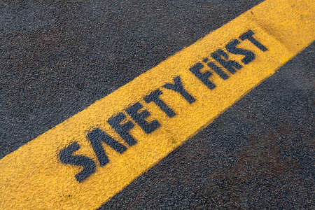 safety first: Safety first sign on road Stock Photo