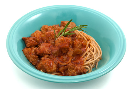Spaghetti with meatballs on white background photo