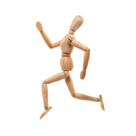 Wood model with running pose isolated on white background photo