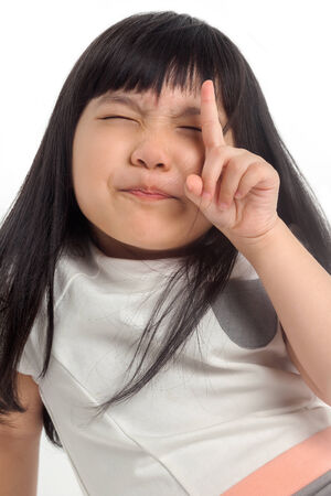 Child pointing up with one finger and funny face photo
