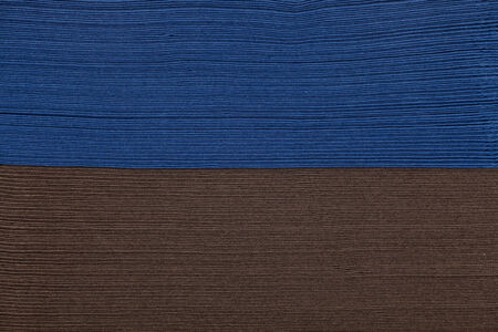 Stack of brown and blue napkin paper closeup texture photo