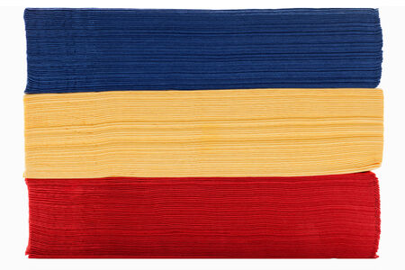 Stack of red yellow and blue napkin paper photo