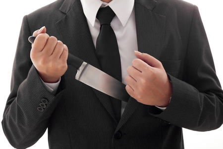 Businessman Holding Knife ready to attack conceptual image Isolated photo