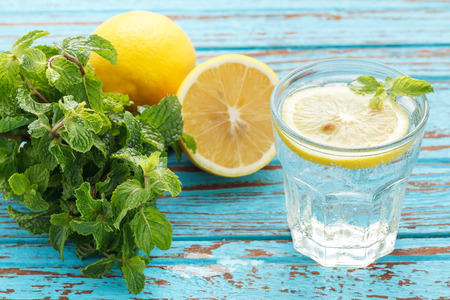 cold drinks: lemon soda mint fresh drink summer refreshment still life blue background wood teak Stock Photo