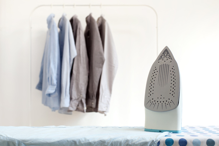 iron: ironing housework ironed folded shirts clean concept still life garment apparel cloth indoors