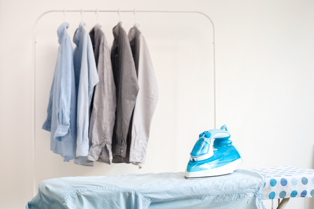 electric iron: ironing housework ironed folded shirts clean concept still life garment apparel cloth indoors