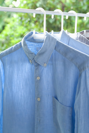 ironed: ironing concept housework ironed folded shirts clean still life garment apparel