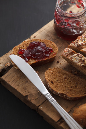 wheat toast: Dark multigrain bread fresh baked rustic breakfast food Whole grain homemade bakery tasty fruit jam berry