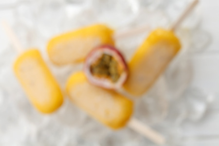out of focus: blur out focus passion fruit  yummy fresh summer fruit sweet dessert on vintage old wood teak white still life