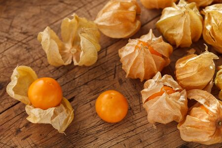 ground cherry: cape gooseberry physalis fruit ground cherry organic food vegetable golden berry tasty wood background