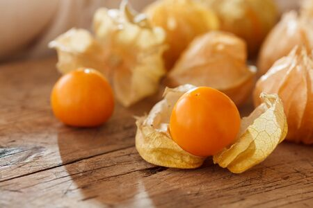 cape gooseberry: cape gooseberry physalis fruit ground cherry organic food vegetable golden berry tasty wood background