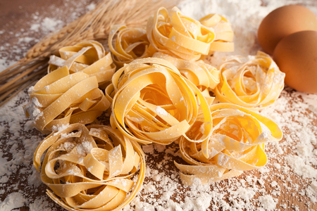 alfredo: fettuccine pasta italian food still life rustic wood background tagliatelle alfredo close up macro Stock Photo