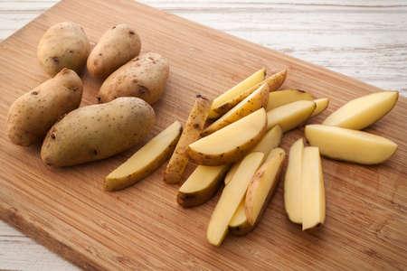 russet: potato ingredient raw rustic still life white wood background