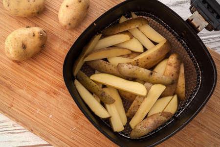 russet potato: potato ingredient raw rustic still life white wood background flat lay