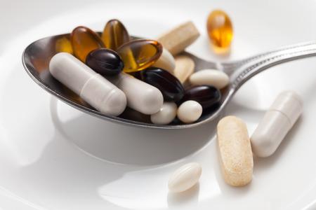 mix supplement antioxidant still life glutathione astaxanthin biotin saw palmetto vitamin c Reklamní fotografie