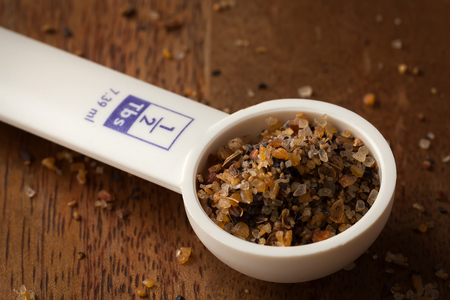 measuring spoon: measuring spoon on wooden background kitchen object tool